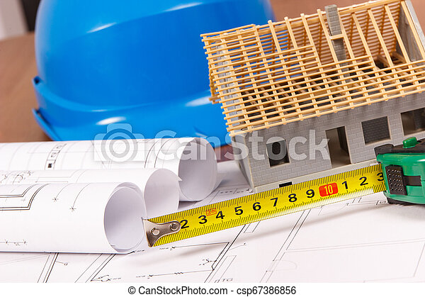 Electrical drawings, work tools for use in engineer jobs and house under construction, building home concept - csp67386856