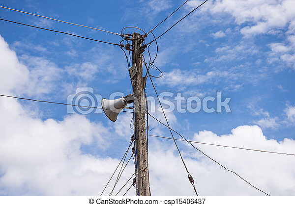 electrical post by the road with power line cables - csp15406437