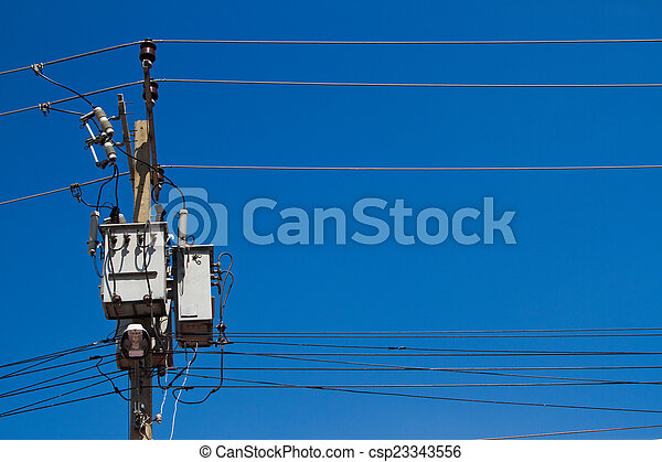 electrical post with power line cables on blue sky - csp23343556