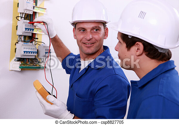 Electrical safety inspectors verifying central fuse box - csp8827705