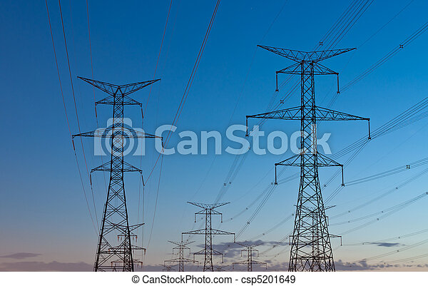 Electrical Transmission Towers (Electricity Pylons) at Dusk - csp5201649