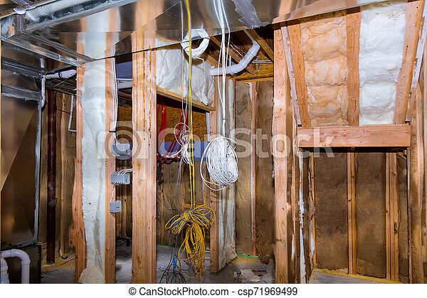 Electrical wiring installed in residential home contruction in the basement.Can Stock Photo