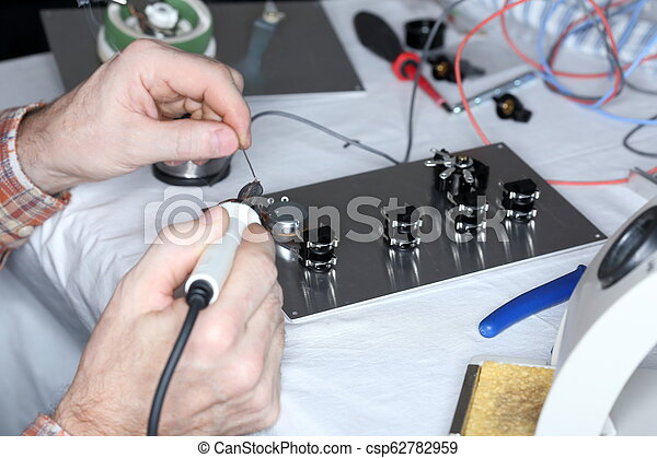 electrical worker is soldering - csp62782959