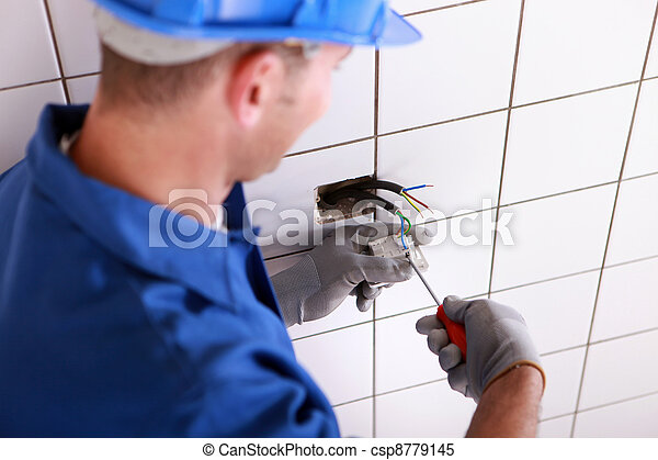 Electrician fitting a electrical point - csp8779145