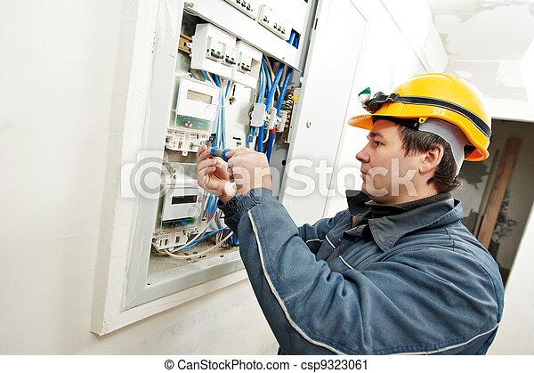 Electrician installing energy saving meter - csp9323061