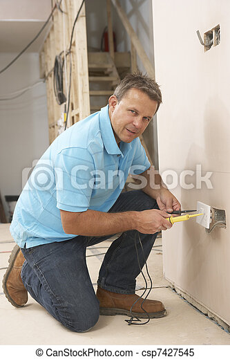 Electrician Installing Wall Socket - csp7427545