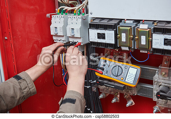 electrician measurements with multimeter tester on