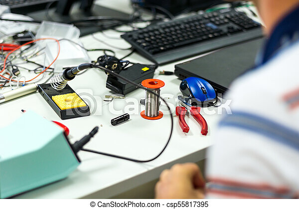 Electrician soldering wires. on