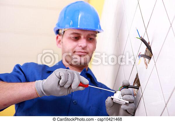 Electrician using screwdriver - csp10421468