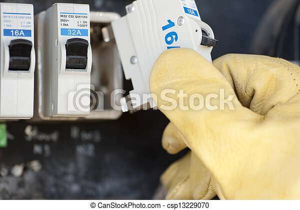 Electrician with electric fuse at switch board - csp13229070