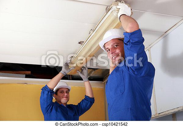 electricians installing neon - csp10421542