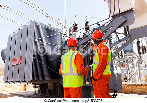 electricians standing next to a transformer - csp21533795