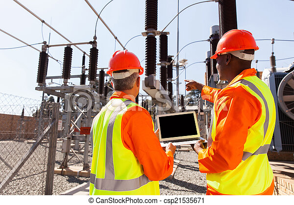 electricians with laptop pointing - csp21535671