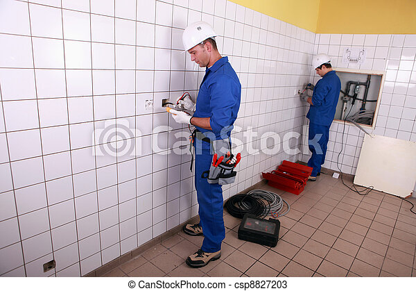 electricians working - csp8827203