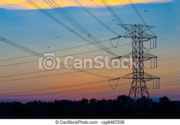 Pilones de electricidad al atardecer - csp6467239