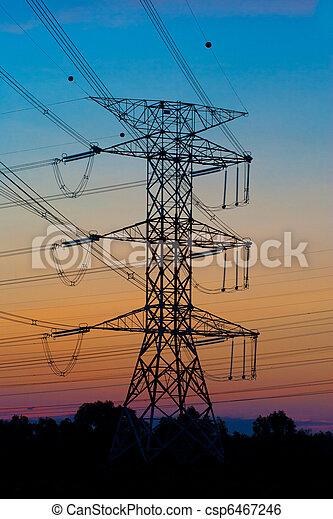 Pilones de electricidad al atardecer - csp6467246