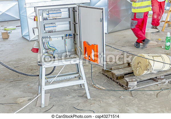 electricity distribution box with wires and circuit breakers, fuse box on  building site
