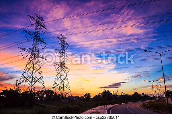 electricity high voltage power pylon at dusk - csp22385011