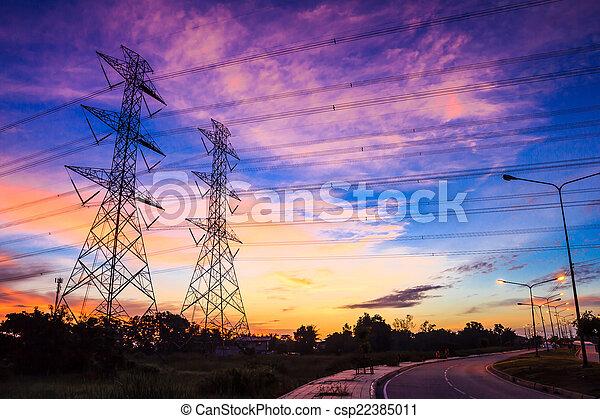 electricity high voltage power pylon at dusk - csp22385011