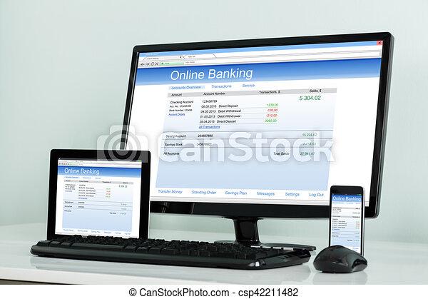 Electronic Gadget Showing Online Banking On Desk - csp42211482