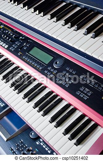 electronic music synthesizer keyboards on rack - csp10251402