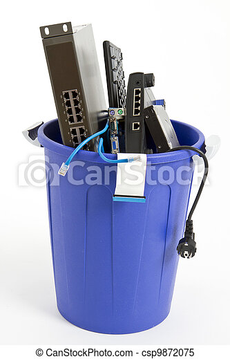 electronic scrap in trash can - csp9872075