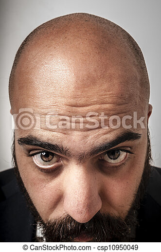 elegant bearded man showing his baldness - csp10950049