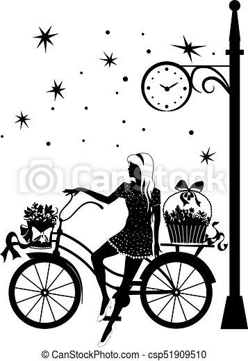 Elegant beautiful woman on a bicycle - csp51909510