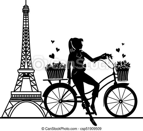 Elegant beautiful woman on a bicycle - csp51909509