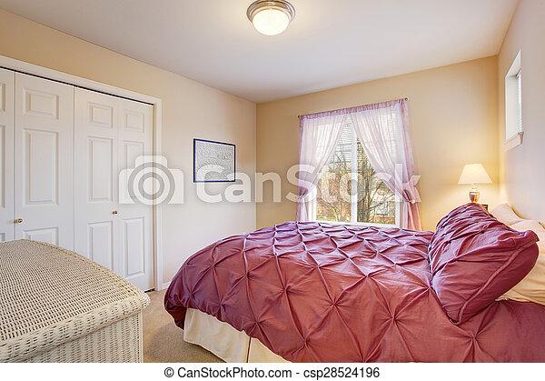 elegant bedroom with fuchsia bedding. - csp28524196
