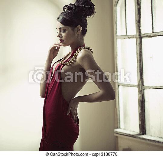 Elegant brunette woman with bun haircut - csp13130770