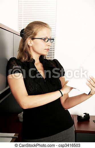 Elegant Business Woman Checking Paper Work - csp3416503