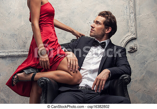 Elegant couple passing in classic clothes. Close up, cut shoot  - csp16382802