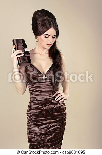 Elegant Fashion Sexy Woman in chocolate dress with small bag - csp9681095