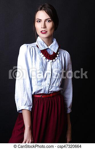a9fb0ed651 Elegant girl in denim blouse and red skirt in studio on white background -  csp47320664