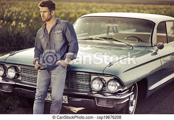 Elegant male model with the retro car - csp19676208