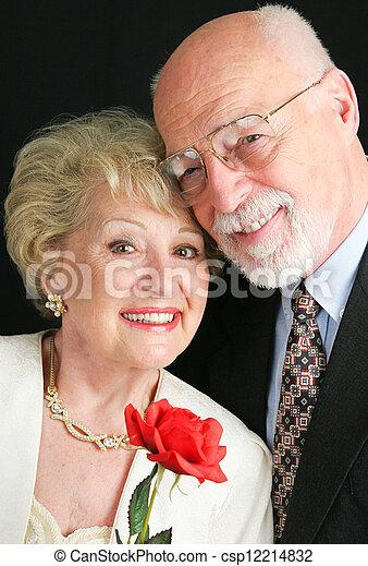 Elegant Senior Couple with Rose - csp12214832