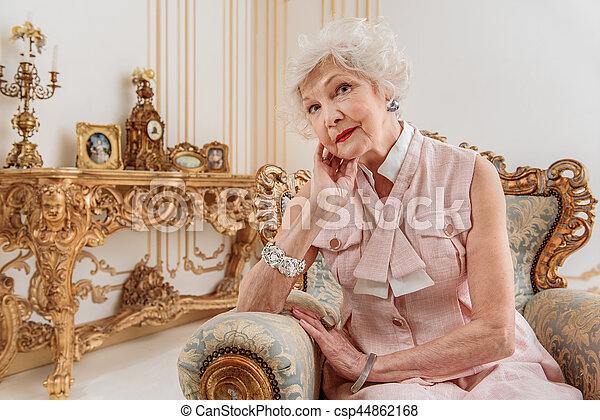 Elegant senior woman sitting on luxury armchair - csp44862168  sc 1 st  Can Stock Photo : old lady chair - Cheerinfomania.Com