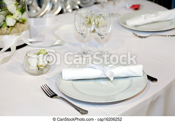 Elegant table setting for a wedding dinner - csp16206252