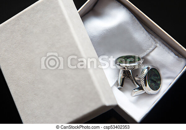 Elegant wedding cufflinks for a classic suit in the box - csp53402353