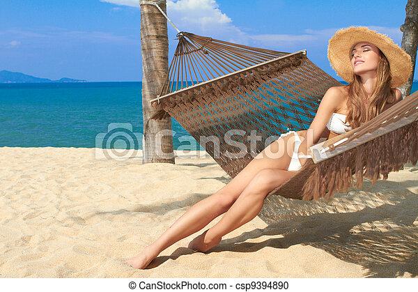 Elegant woman reclining in a hammock - csp9394890