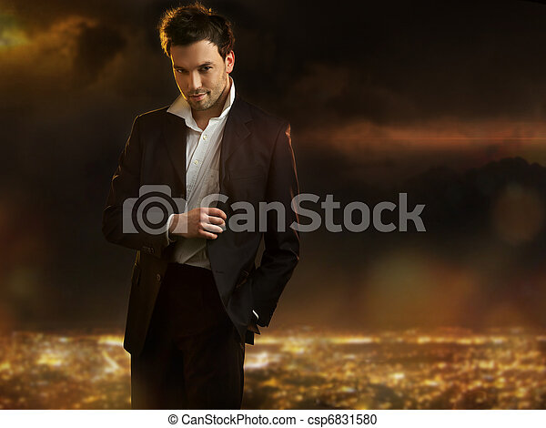 Elegant young handsome man over night city background - csp6831580