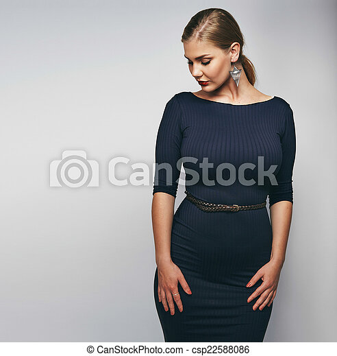 f228fcd7a7c Elegant young lady in black dress. Studio image of elegant young ...