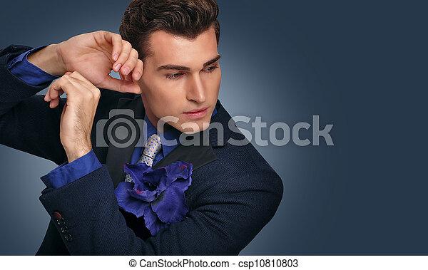 Elegant young man in jacket. Fashi - csp10810803