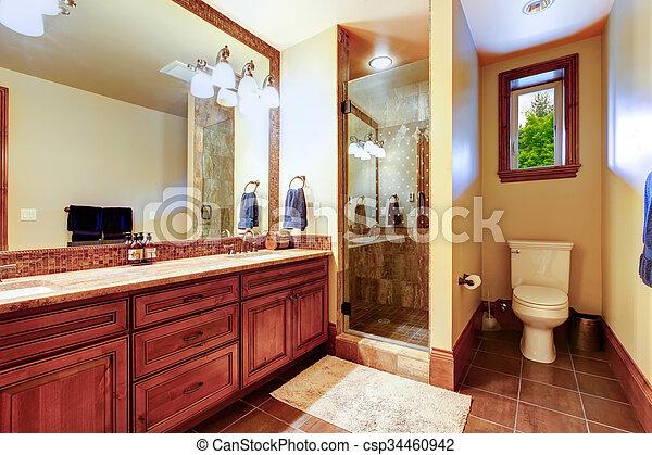 Baño elegante con interior de color cálido. - csp34460942