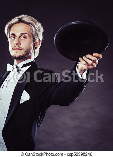 14d64ccbff0ca Elegantly dressed man throwing black fedora hat - csp52398246