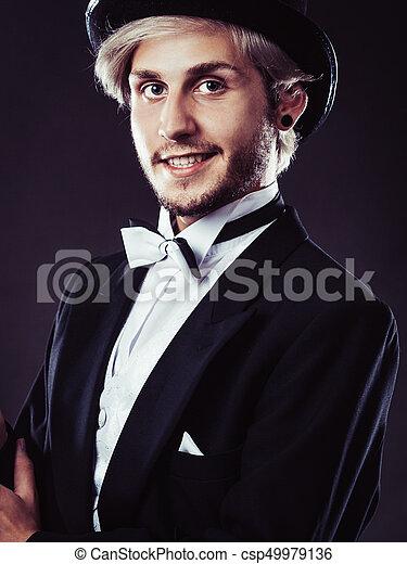 b8e79207ed6b5 Elegantly dressed man wearing black fedora hat - csp49979136