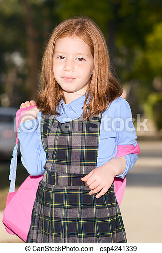 Elementary age schoolgirl in uniform with backpack - csp4241339