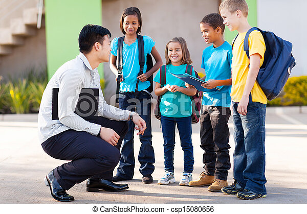 elementary pupils outside classroom talking to teacher - csp15080656