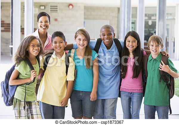 Elementary school class with teacher - csp1873367